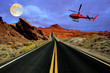 Helicopter tour over desert road with full moon