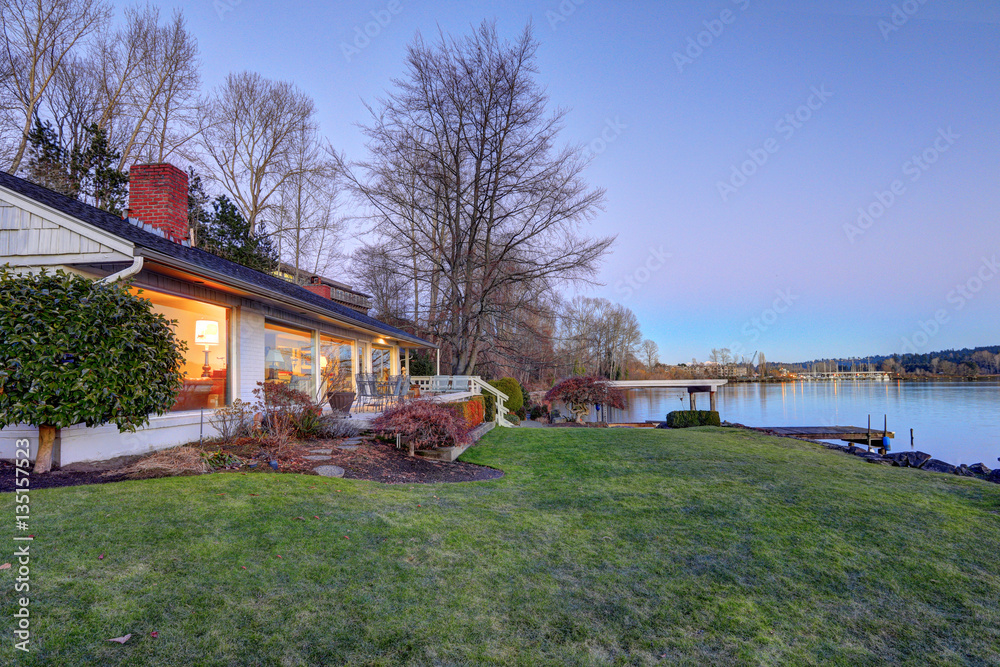 Fototapeta Lovely waterfront home with private dock