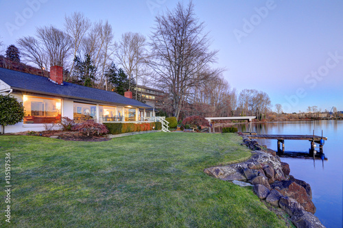Obraz Lovely waterfront home with private dock - fototapety do salonu