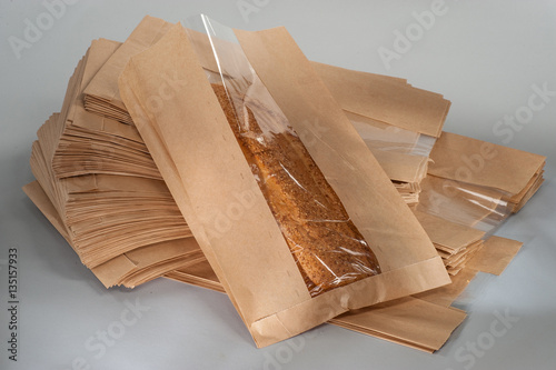 bread baguette with sesame seeds in paper packaging