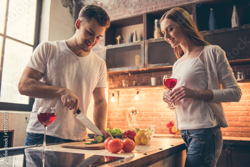 Foto op Canvas Koken Beautiful couple cooking