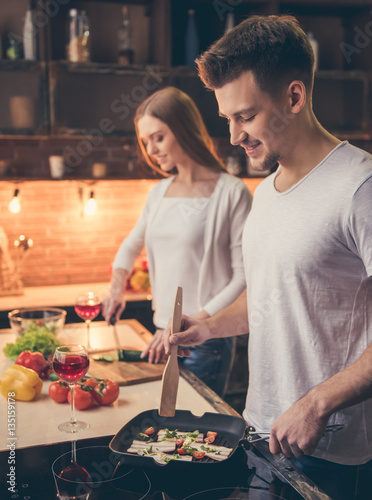 Poster Cuisine Beautiful couple cooking