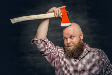 Fat bald, bearded man holds...