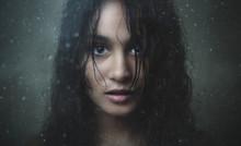 Girl Staring Through Rainy Glass