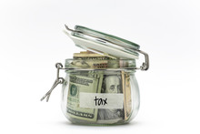 Dollar Bills In Glass Jar Isol...