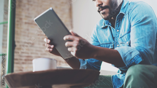 Pensive African Man Using Tablet For Video Conversation While