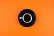 Leinwanddruck Bild - Coffee cup on bright orange background