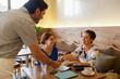 Women paying bill at restaurant.