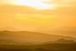 Rolling rural landscape at sunset