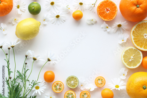 Fotografie, Obraz  Frame of various citrus fruits and  marguerite flower,top view