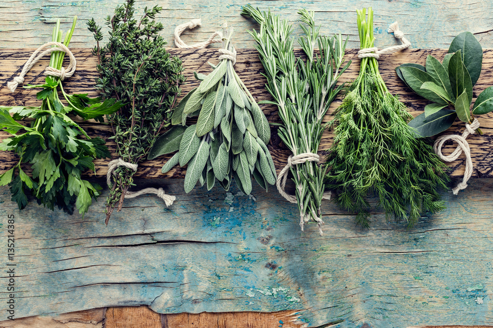 Fototapety, obrazy: fresh herbs on wooden background with space for text