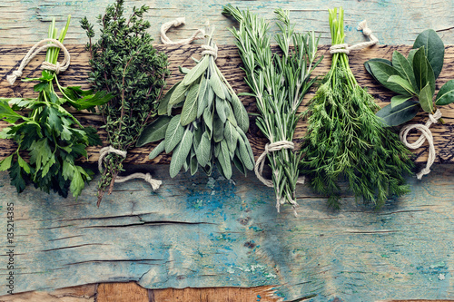 Poster Aromatische fresh herbs on wooden background with space for text