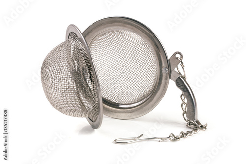 Fényképezés  tea strainer on a chain isolated  white background