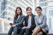business woman group sit on stairs