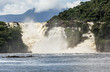 Golondrina falls and tourists boat in the lagoon of Canaima national park - Venezuela, South America