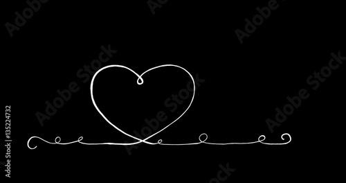 Fotografia  Verziertes Herz auf schwarzer Tafel