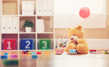 Teddy Bear Surrounded By Toys