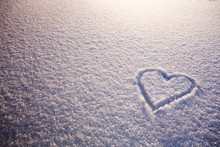 Beautiful Romantic Background With Heart On Snow