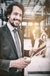 Portrait of businessman holding digital tablet