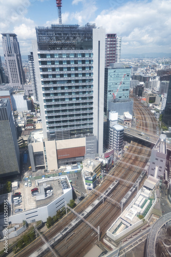Fototapety, obrazy: modern office building and railway track of Osaka city, Japan