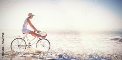 Foto  Woman riding bike