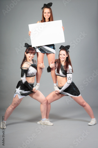 Fotografiet  Cheerleader Team Performing A Thigh Stand