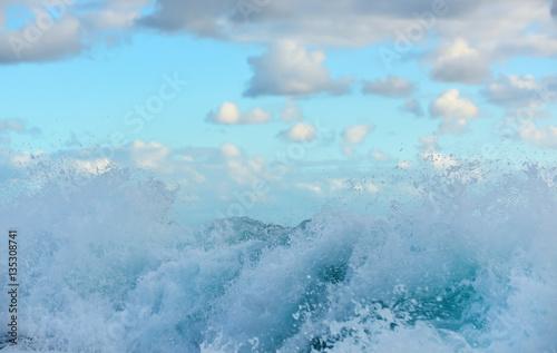 Poster Mer / Ocean wave on the ocean and gentle clouds. sea breeze