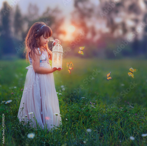Fairytale portrait of Little girl with lightning at the night field Poster