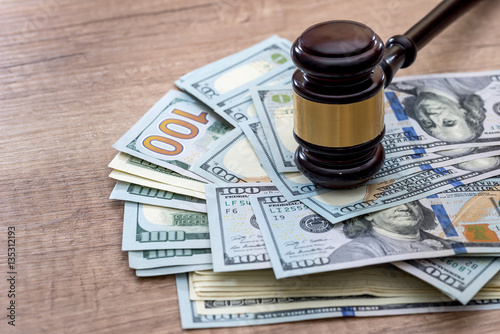 wooden gavel with usa dollar on desk. close up. Wallpaper Mural