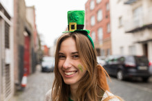 Young Ireish Woman With A Funny Hat For St Patrick's Day Dublin