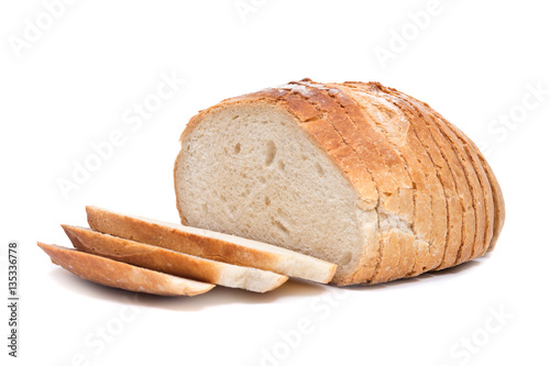 Fotografie, Obraz  Sliced crusty country style round organic french bread isolated on white backgro