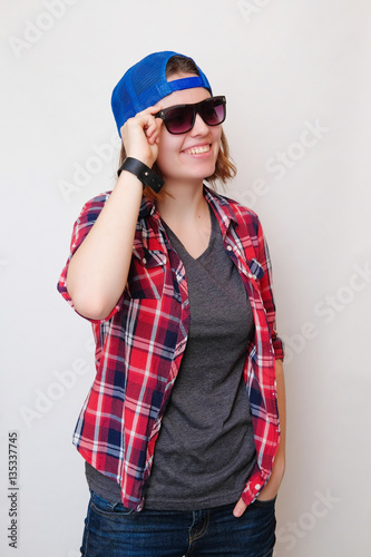 db29995e8c4 Hipster girl with short hair in a red plaid shirt