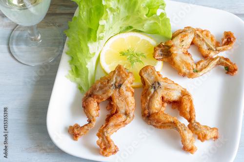 Foto op Plexiglas Kikker Fried frog legs on plate food concept