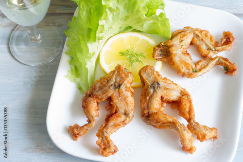 Tuinposter Kikker Fried frog legs on plate food concept