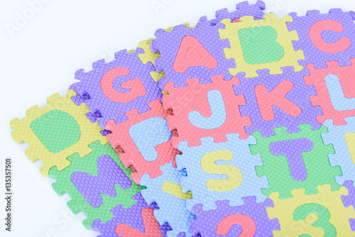 Staande foto Hoogte schaal Colorful foam alphabet isolated on white