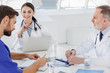 Professional medical team working together at hospital