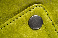 Metal Button On Green Color Leather Jacket. Lime Color. Macro Leather Jacket Detail. Clasp Button