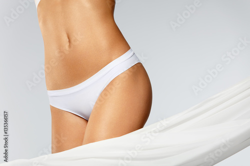 Fototapeta Health. Closeup Of Beautiful Slim Woman Body In Perfect Shape obraz na płótnie