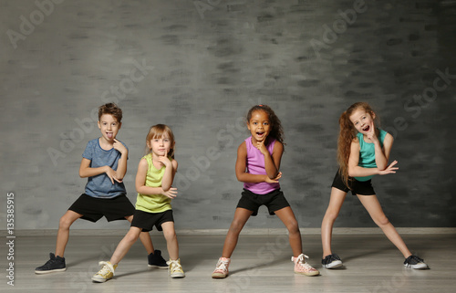 Deurstickers Dance School Cute funny children in dance studio