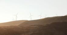 Wind Turbines On Hillside At Dusk
