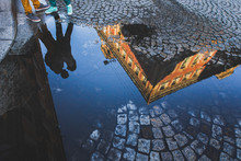 Silhouette Hugging Guy And Girl In Reflection In Puddle On A Street