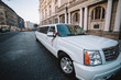 beautiful and glamorous wedding white limousine stands outdoors