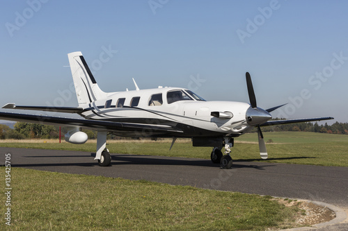 Fotografia, Obraz  Private small single turboprop aircraft on airport runway