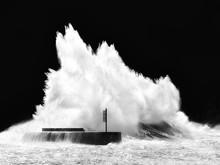 Big Wave Breaking On Breakwater