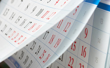 Flipping Of Calendar Sheets With Black And Red Numbers
