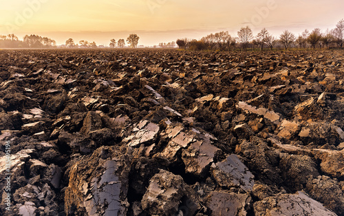 Fotobehang Cultuur plowed soil. spring field. sunset over ploughed field. Countrysi