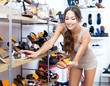 Woman looking after pair of shoes