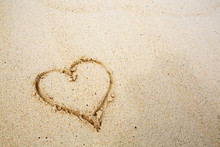 Hearts Drawn On The Sand Of A Beach.