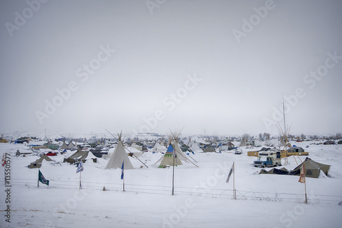 Fotografie, Obraz  Cloudy, snowy day at Oceti Sakowin Camp, Cannon Ball, North Dakota, USA, January