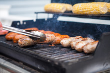 Corn And Sausage On A Summer Gas Grill Barbecue Being Cooked